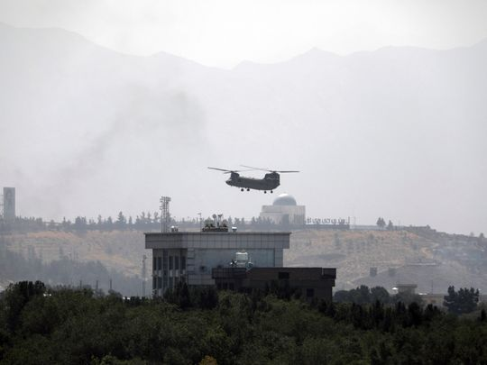 A US Chinook helicopter flies near the US Embassy