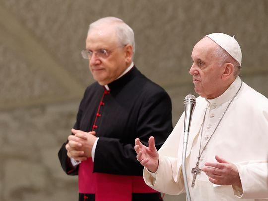 Pope Francis, flanked at left by Monsignor Leonardo Sapienza