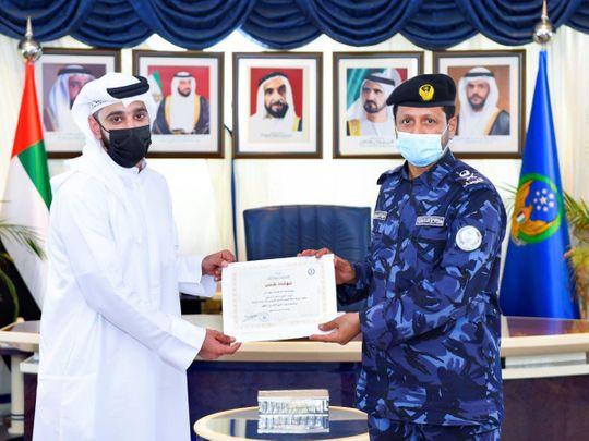 Sharjah Police  chief honours man-1629441061514