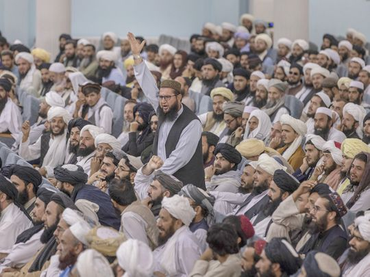 People attend the Taliban's Preaching and Guidance Commission public event