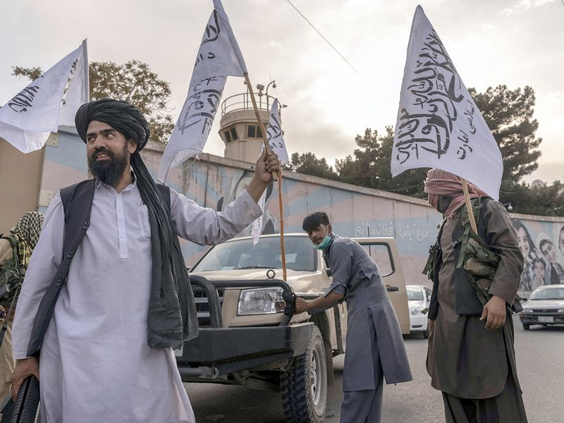 Taliban members outside the closed United States embassy in Kabul.
