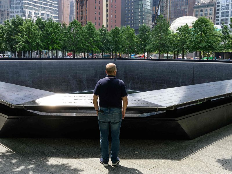 Joseph Dittmar, a survivor of the September 11, 2001 World trade Center attacks stands before a 9/11 memorial marking the site of the south tower where he was working on the 105th floor at the time, in New York City.