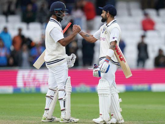 Cricket - Pujara (left) & Kohli