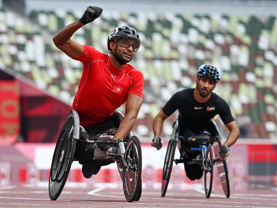 UAE's Mohammed Al Hammadi, right, with gold medal winner Walid Ktila after the men's wheelchair 100m T34 at the Tokyo 2020 Paralympics