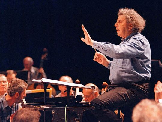 FILE PHOTO: Greek composer Mikis Theodorakis conducts the Skopje's opera orchestra during a rehearsal in the Macedonian capital, April 9, 1997. Stringer/File Photo
