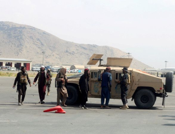 Copy of 2021-08-31T121631Z_15084798_RC29GP9F1VSI_RTRMADP_3_AFGHANISTAN-CONFLICT-AIRPORT-TALIBAN-1630647863450