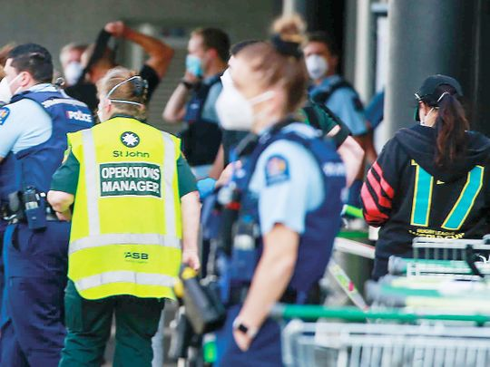 Police and ambulance staff outside an Auckland supermarket,