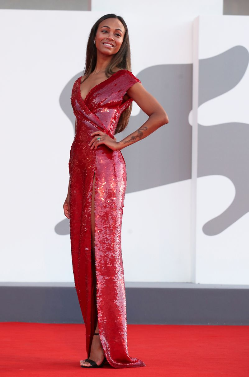 The 78th Venice Film Festival - Screening of the film 'The Hand of God' in competition- Red Carpet Arrivals - Venice, Italy September 2, 2021 - Actor Zoe Saldana poses. REUTERS/Yara Nardi