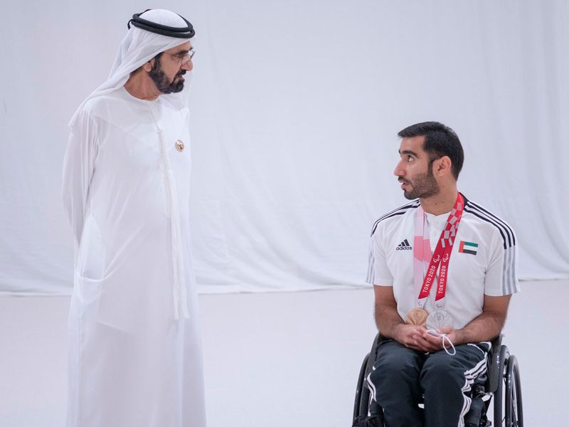Sheikh Mohammed speaks with the UAE's double Paralympic medal winner Mohammed Al Hammadi