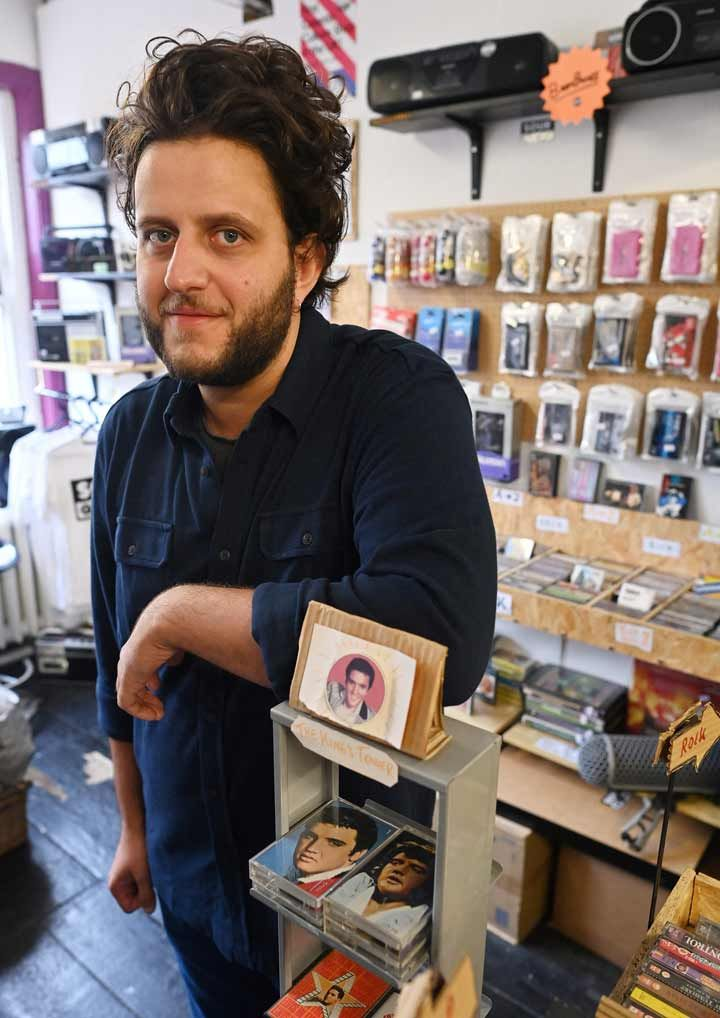 Giorgio Carbone, co-founder of Mars Tapes poses in his shop in Manchester.