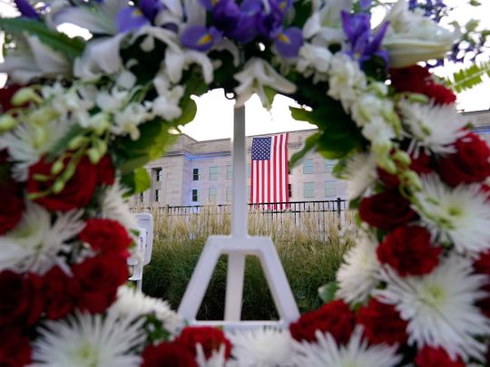 An American flag is unfurled at the Pentagon in Washington, Saturday, September 11, 2021, at sunrise on the morning of the 20th anniversary of the terrorist attacks. The American flag is draped over the site of impact at the Pentagon.