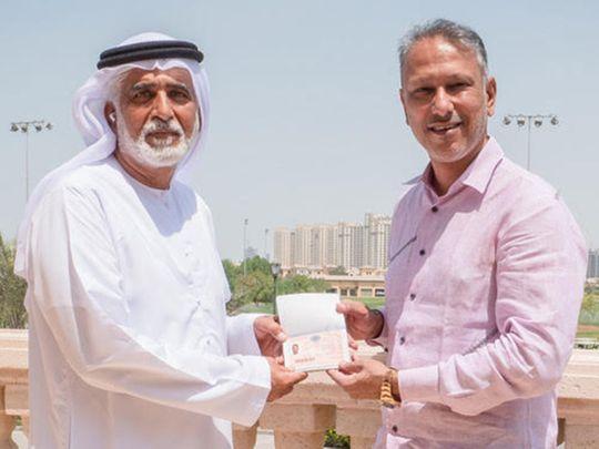 Indian golfer Jeev Milkha Singh receiving his Dubai Golden Visa from Ismail Sharif, Managing Director of Jumeirah Golf Estates.