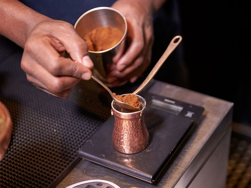 Add coffee powder to the pot/cezva