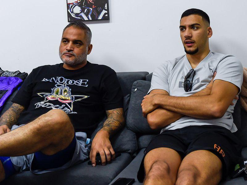 Hamzah Sheeraz with coach Ricky Funez chatting with Gulf News