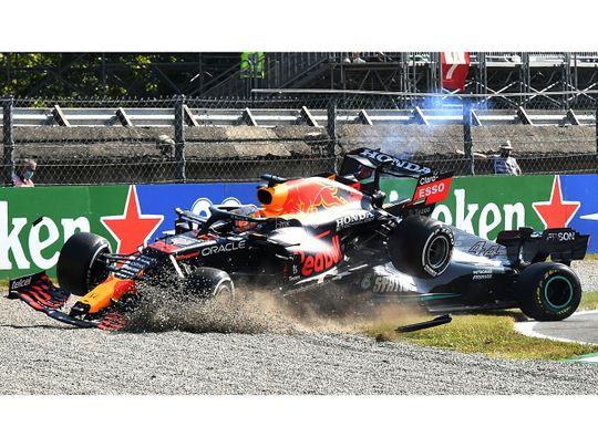Red Bull's Max Verstappen crashes over Mercedes' Lewis Hamilton during the Italian Grand Prix