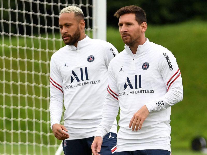 Paris Saint-Germain's Lionel Messi in training with teammate Neymar