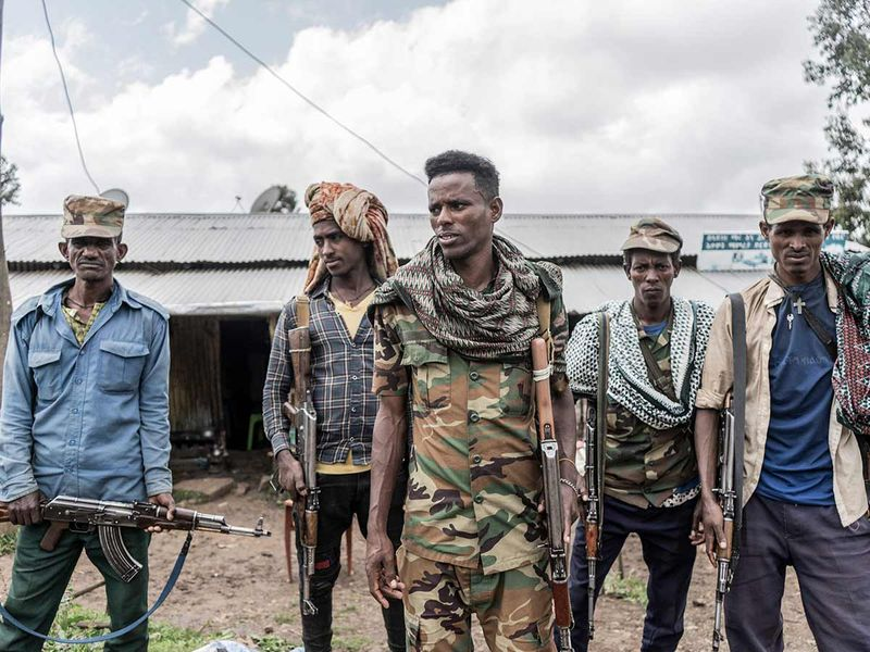 Amhara militiamen stand on guard in a rural area near the village of Dabat, 70 kilometres northeast of the city of Gondar, Ethiopia, on September 14, 2021.