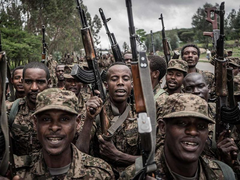 Ethiopian National Defence Forces (ENDF) soldiers shout slogans after finishing their training in the field of Dabat, Ethiopia, on September 14, 2021.