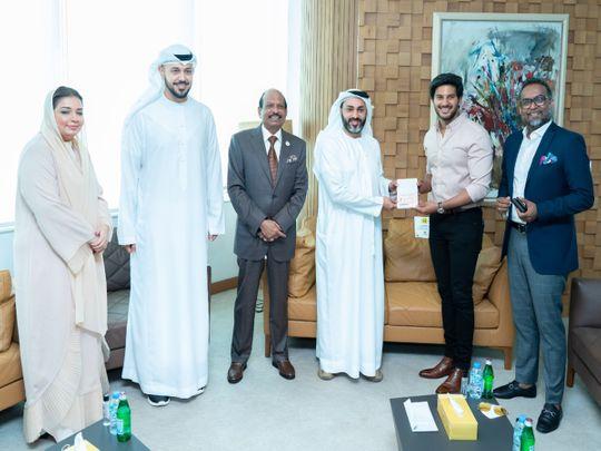 Dulquer Salmaan receiving his UAE Golden Visa