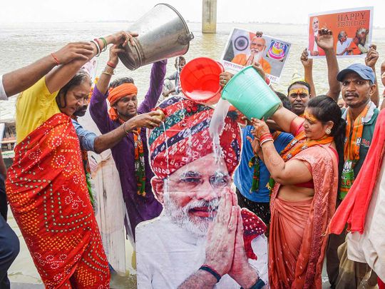 BJP supporters perform rituals on the banks of river Ganga