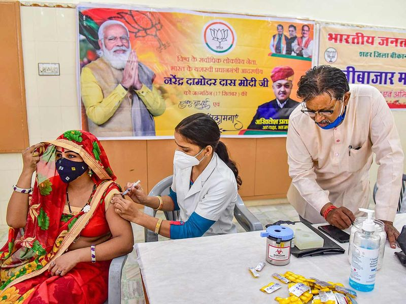 Beneficiaries receive a dose of COVID-19 vaccine
