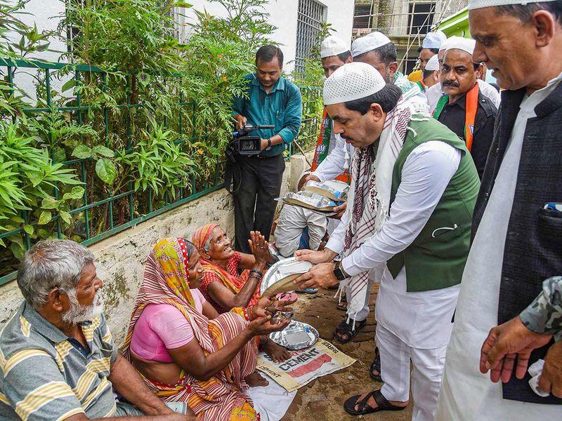 Bihar state minister Shahnawaz Hussain distributes food