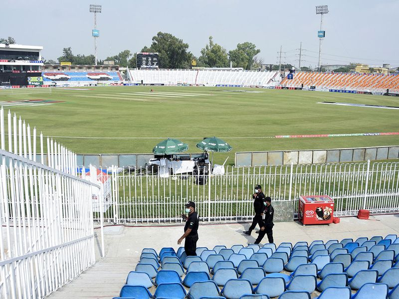 Members of the Police Elite Force walk in an enclosure at the Rawalpindi Cricket Stadium after the New Zealand cricket team pulled out of a Pakistan cricket tour over security concerns