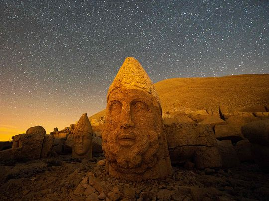Photos: Massive stone head statues bask in stunning sunrise