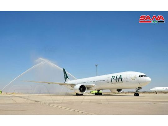 The PIA plane lands at Damascus airport.
