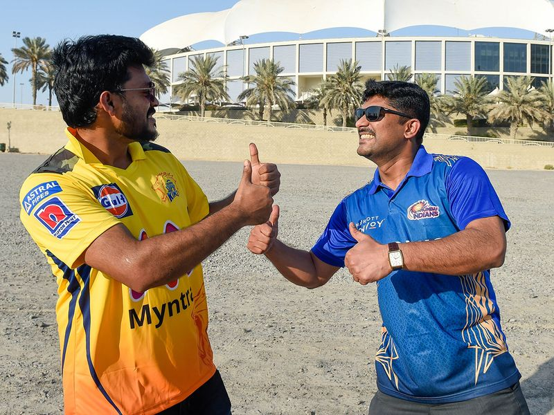 Chennai fan Mohammad Ajas and Mumbai Indians supporter Tony Joseph arrive to watch the first game of the second leg of IPL 2021