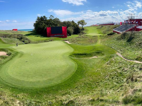 Temporary grandstands are set up around the 18th hole at Whistling Straits Golf Course in preparation for the Ryder Cup