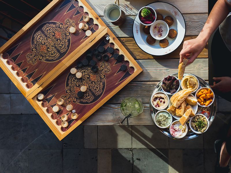 A traditional mezze platter served with small bowls of appetizers