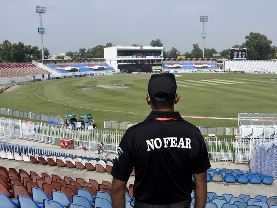 A member of the Police Elite Force stands guard at the Rawalpindi Cricket Stadium in Pakistan