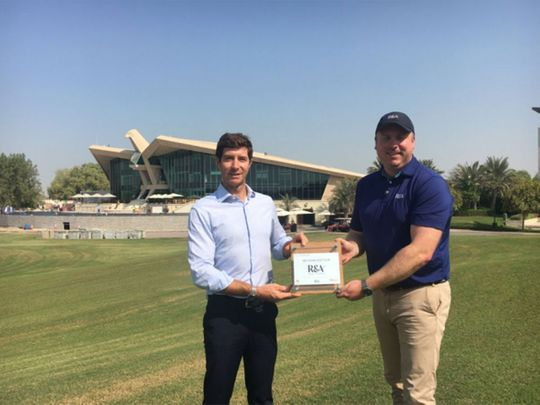 Andrea Faldella, Club Operations Manager, Abu Dhabi Golf Club, receiving the 'R&A Women in Golf Charter' Certificate from Ed Johnson, Assistant Director - R&A Amateur Championships.