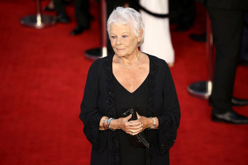 Actor Judi Dench poses as she arrives at the world premiere of the new James Bond film