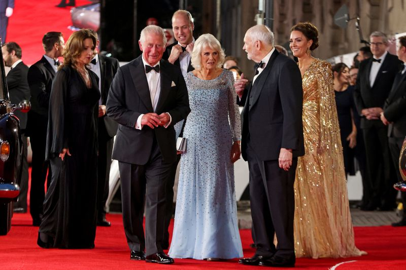 Barbara Broccoli, left and producer Michael G. Wilson, centre right, walk with Britain's Kate, the Duchess of Cambridge, right,  Prince William, background,  Camilla, the Duchess of Cornwall, centre and Prince Charles, centre left as they arrive for the World premiere of the new film from the James Bond franchise 'No Time To Die', in London, Tuesday, Sept. 28, 2021. (Chris Jackson/Pool Photo via AP)