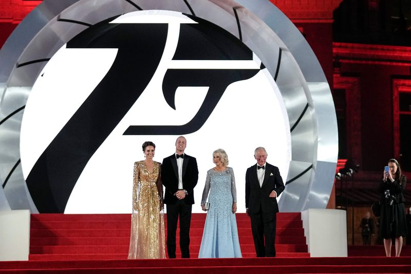 Britain's Prince Charles, from centre right, his wife Camilla the Duchess of Cornwall, Britain's Prince William and his wife Kate the Duchess of Cambridge pose for photographers upon arrival for the World premiere of the new film from the James Bond franchise 'No Time To Die', in London Tuesday, Sept. 28, 2021. (AP Photo/Matt Dunham)