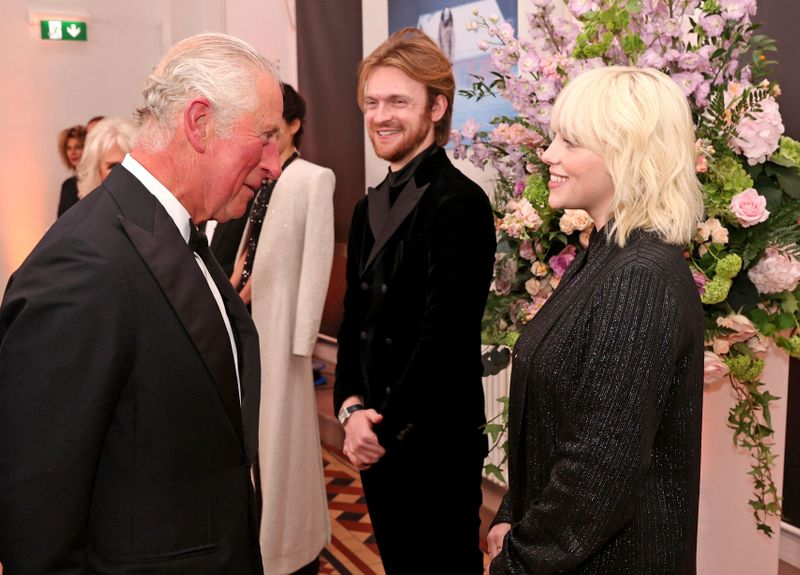 Britain's Prince Charles, left, speaks with performers Finneas O'Connell and Billie Eilish upon arrival for the World premiere of the new film from the James Bond franchise 'No Time To Die', in London, Tuesday, Sept. 28, 2021.