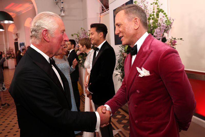 Britain's Prince Charles speaks with actor Daniel Craig at the world premiere of the new James Bond film