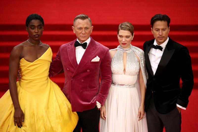 Cast members Lashana Lynch, Daniel Craig, Lea Seydoux and director Cary Fukunaga pose during the world premiere of the new James Bond film