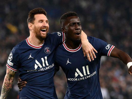 Paris Saint-Germain's Idrissa Gana Gueye celebrates with Lionel Messi