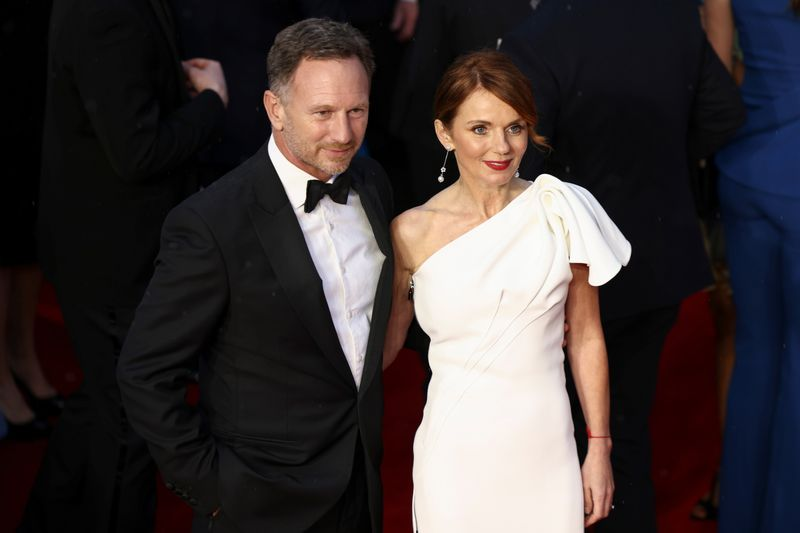 Singer Geri Halliwell and her husband Red Bull team principal Christian Horner pose as they arrive at  the world premiere of the new James Bond film