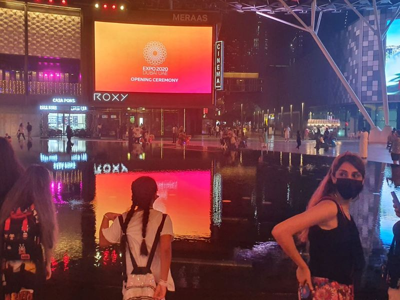 Residents wait in anticipation for the live streaming of Expo 2020 opening ceremony at City Walk.