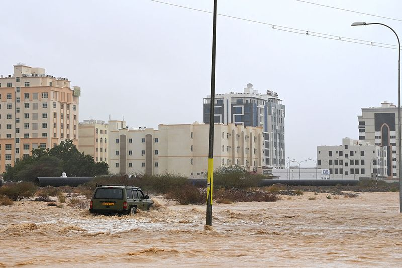 Flooded streets are seen as Cyclone Shaheen makes landfall in Muscat Oman.