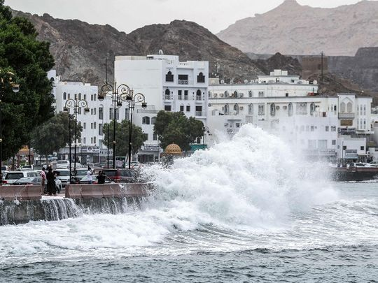 High waves break on the Mutrah sea side promenade in the Omani capital Muscat on October 2, 2021, as the Shaheen tropical storm hits the country.