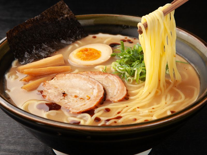 Soupy bowl of ramen with meat and eggs