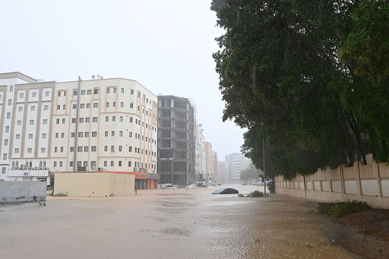 Cars are seen abandoned on a flooded street as Cyclone Shaheen makes landfall in Muscat Oman, October 3, 2021.