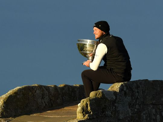 Danny willet celebrates on the famous St Andrews Old Course bridge after the Alfred Dunhill Links Championship
