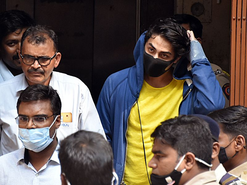 Maharashtra, Oct 4 (ANI): Bollywood actor Shah Rukh Khan's son Aryan Khan along with other accused leaves the NCB office after an inquiry as he is arrested in an allegedly drug-related case, in Mumbai on Sunday