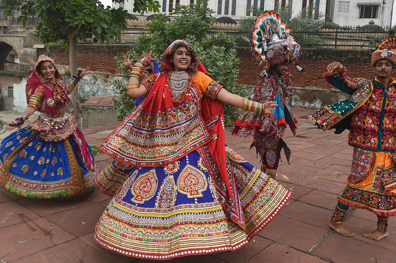 Traditional dancers rehearse ahead of the Hindu festival 'Navratri' in Ahmedabad on September 27, 2021.